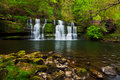 Lush spring waterfall Royalty Free Stock Photography