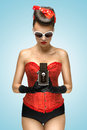 The lust of vintage photographer a photo pin up girl in corset holding camera Royalty Free Stock Image