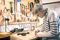 Luthier drawing the outline of a lute piece Royalty Free Stock Photo