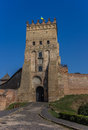 Lutsk castle with the ukrainian flag on top in Royalty Free Stock Photos
