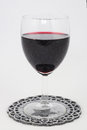 Luxe glas of red wine on a white background Royalty Free Stock Images