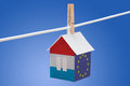 Luxembourg and eu flag on paper house concept painted a hanging a rope Stock Photos