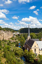 Luxembourg view from above on to the neumunster abbey in grund the casemates and the river alzette flowing in the valley Stock Images