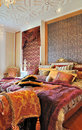 Luxuriant bedroom in warm color Royalty Free Stock Image