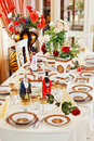 Luxuriant table appointments with red porcelain Royalty Free Stock Photo