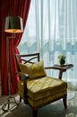 Luxurious armchair in the sun shine Royalty Free Stock Photo