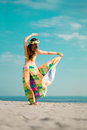 Luxurious beautiful fashionable woman on the beach at sun Stock Images