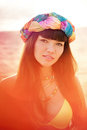 Luxurious beautiful fashionable woman on the beach at sunset Royalty Free Stock Images