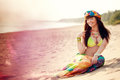 Luxurious beautiful fashionable woman on the beach at sunset Royalty Free Stock Image