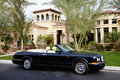 Luxurious convertible car parked in front of a mansion house Royalty Free Stock Photo