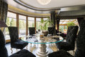 Luxurious dining room with glass table Royalty Free Stock Photo