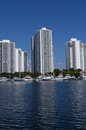 Luxurious florida condominiums on bay three with docks for yachts and boats the water in beautiful sunny south Stock Photography