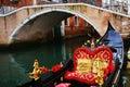 Luxurious gondola parked and iron bridge, Venice, in Italy, Europe Royalty Free Stock Photo