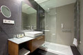Luxurious hotel resort bathroom an image of a modern upscale interior in a new fitted with shower area large mirror on the wall Stock Images