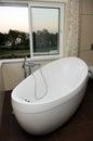 Luxurious and Modern White Bathtub - Window View Royalty Free Stock Photo
