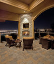 Luxurious outdoor patio at night with view of city lights Stock Image
