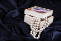 Luxurious pearls an ornated wooden box containing a beautiful pearl necklace Stock Photos