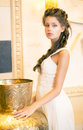 Luxurious Posh Brunette in White Dress. Oriental Antique Golden Decor Royalty Free Stock Photo