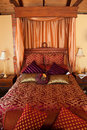 Luxurious red purple bed Royalty Free Stock Photo