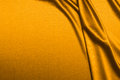 Luxurious satin gold background closse up Stock Images