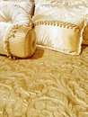 Luxurious silky bedding bed with and decorative cushions Stock Images