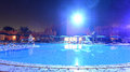 Luxurious swimming pool at night scenic view of hotel illuminated Royalty Free Stock Images