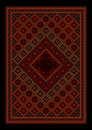 Luxurious vintage oriental carpet with colored ornament in maroon and red shades Royalty Free Stock Photo