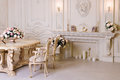 Luxury apartment, comfortable classic living room. Luxurious vintage interior with fireplace in the aristocratic style.