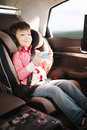 Luxury baby car seat for safety with happy kid Stock Image