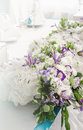 Luxury banquet table with rich decoration of flowers lush leaves, white hydrangea, cream roses, purple eustoma, blue Royalty Free Stock Photo