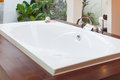 Luxury bathtub with small outdoor view Royalty Free Stock Photo