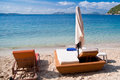 Luxury beach sunbeds empty and umbrellas at majorca mallorca resort in formentor Stock Photos