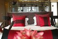 Luxury bedroom front view of neat mattress and red cushion in a Stock Photography