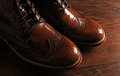 Luxury brown shoes on wood background a pair of close up Stock Images