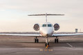 Luxury business jet stands at the airport and ready for boarding. Private aircraft front view Royalty Free Stock Photo
