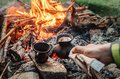 Luxury camping concept. Fresh coffee prepared in turkish cezva o Royalty Free Stock Photo