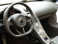 Luxury car dashboard interior and with textured steering wheel and control panel Stock Photo