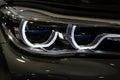 Luxury car headlight detail close up Stock Photos