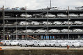 Luxury cars wrapped for protection await export at docks Royalty Free Stock Photo