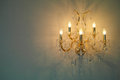 Luxury chandelier golden on the grey wall Stock Photos