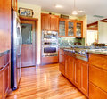 Luxury cherry wood kitchen interior with hardwood. Stock Photo