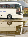 Luxury coach bus and reflection. Royalty Free Stock Photo