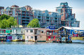 Luxury condominiums tower over colorful house boats Royalty Free Stock Photo