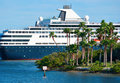 Luxury cruise ship cruising by island Stock Photography