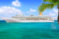 Luxury cruise ship sailing from port Stock Images