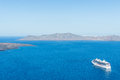 Luxury cruise ships, caldera and volcano near Fira, capital of the Greek Aegean island, Santorini, Greece. Panorama Royalty Free Stock Photo