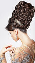 Luxury fashion model with trendy updo braided t classy woman brown hairs posing vogue style Royalty Free Stock Images