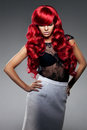 Luxury fashion trendy young woman with red curled hair. Girl w