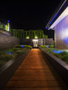 Luxury garden with a fountain at night Royalty Free Stock Photo