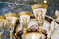 Luxury golden goblets on a showcase in white and color closeup photo with lots of copy space Royalty Free Stock Images